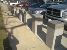 K-12 rated bollards with concrete sleeves